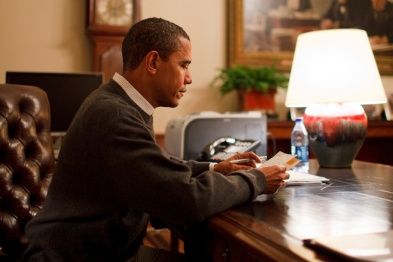 Barack_Obama_reading_a_letter_in_the_Treaty_Room